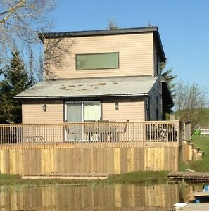 FOR SALE: Water Front Cottage - MLS # SK601885