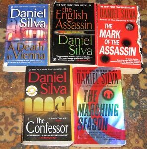 Lot of Daniel silva books $5