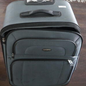 It is a spinner - 26 inch Samsonite Suitcase