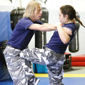 Self-defence training in exchange for ASL translation