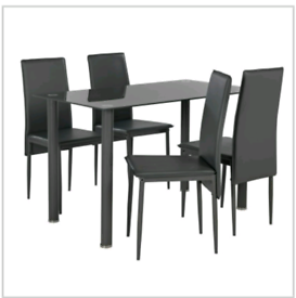 Brand new black glass dining table and 4 chairs