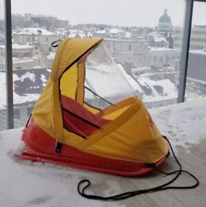 Baby sled with windshield