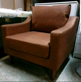 A new stylish tan leather effect arm chair.