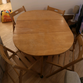 Wooden folding table with four folding chairs
