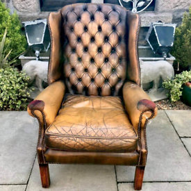 Leather Chesterfield wingback chair with tweed patches