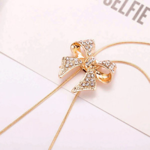 Gold and sliver bow necklace