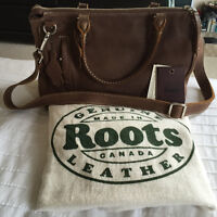 BRAND NEW PURSE BY '' ROOTS '' ON SALE