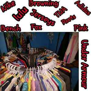 100 pieces of name brand clothing!