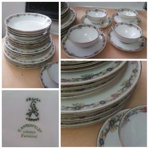 Limoges 4 place settings with matching cups and saucers