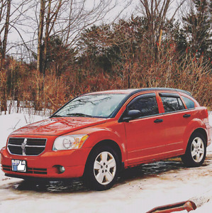 2009 dodge calibre 2.0L sxt. Am open to trades