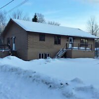 PRICED TO SELL LOG CONSTRUCTION HOME