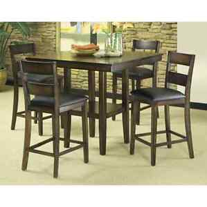 Pub style table and 4 chairs with leather cusions.