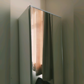 Sturdy small white wardrobe with mirror door