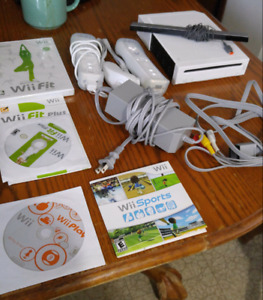 Nintendo Wii, controllers, cords, 4 games