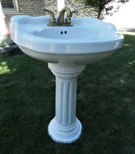 White pedestal sink,nice detail,brass fittings if wanted
