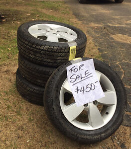 Full set of tires + rims, used for less than a season