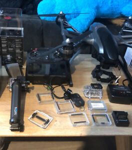 Go pro hero 4 ( black) and drone , lots of accessories.