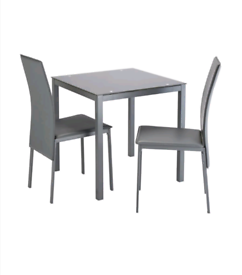 Grey Glass Dining Table with 2 Chairs £75. Real Bargains Clearance Out