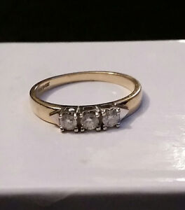 3 Stone diamond yellow gold ring