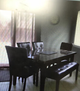 Dining table,  4 chairs and a bench for sale!