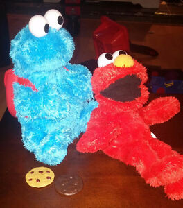 Elmo and cookie monster toys