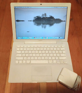 Apple Macbook White with new battery and 250gb hard drive