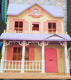Fisher Price dolls house with dolls and furniture
