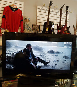 """""""sold""""   Philips 32"""" TV with remote"""