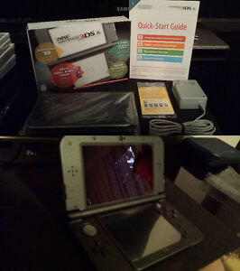 New 3DS XL *IPS* (HD) dans sa boite, chargeur, micro sd et+