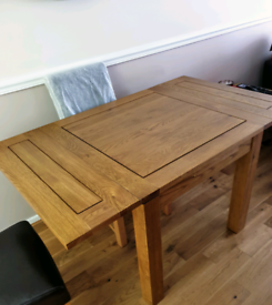 PRICE REDUCED Solid oak extending dining table