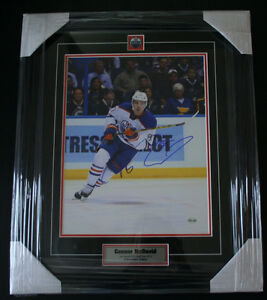 Professionally Framed Autographed Hockey Photos - Connor McDavid