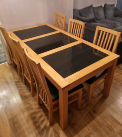 Large solid wood/granite dining table & 6 chairs