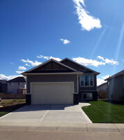 Beautiful Brand New Main Level Suite with Double Garage