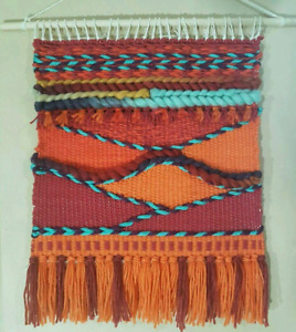 Wall hanging, hand woven made on hand loom.
