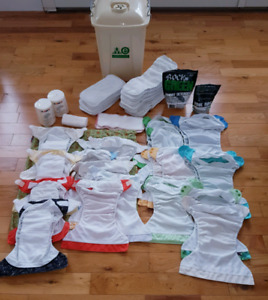 Lot of reusable diapers, storage bag and container and laundry p