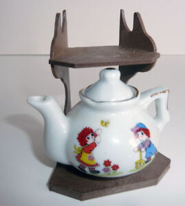 Mini Tea Pot on Shelf and Small Saucer Plate