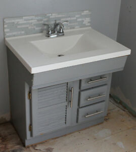 "31"" x 19""  vanity with white cultured marble top and Moen faucet"