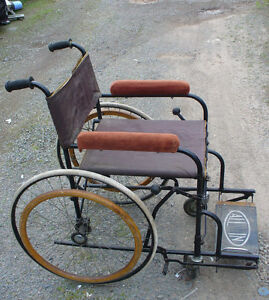 strange antique fold up wheelchair steam punk , wood & Steel