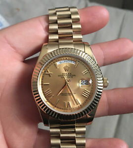 ROLEX DAY DATE GOLD ON GOLD/BLACK