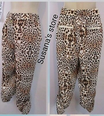 NWT bebe Frankie Point Joggers SIZE M Sleek and sexy. Cheetah Print Go Wild!
