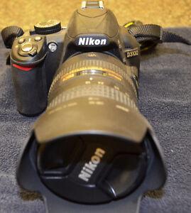 Nikon D3100 DSLR camera with 18-200 mm VR Lens