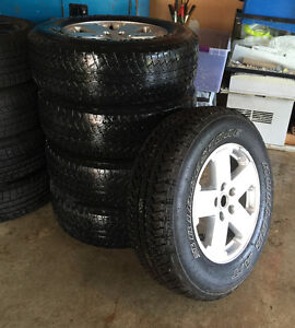 set of 5 Jeep rims and tires (mounted) for sale (P255/70R18)