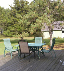 glass top patio table with 4 chairs
