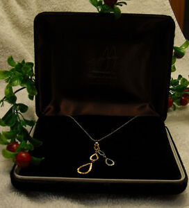 14kt white gold necklace with 16 inch chain & 14kt pendant
