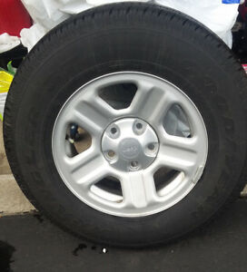 500 km  New Tires on Jeep Rims