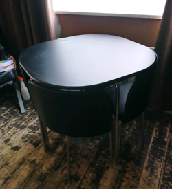 Space saver dining table and chairs.