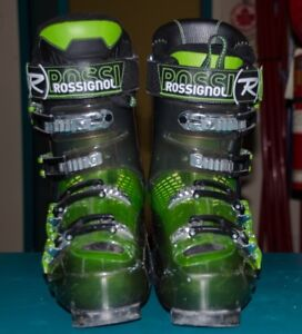 Downhill skis and boots for sale.