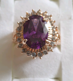 Brand new gold plated with purple stone ring