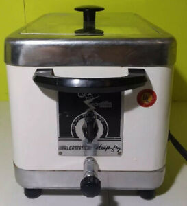 NEW NEVER USED DEEP FRYER AND SLOW COOKER COMBO. .