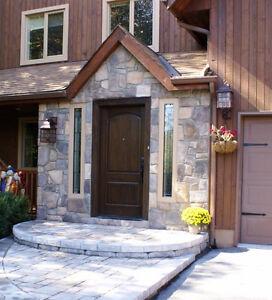 Fiberglass front door with bronze handle and frame